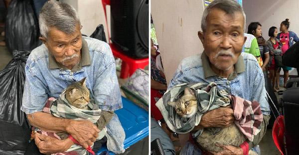 """คุณตาหอบลูกแมวหนี """"พายุปาบึก"""" เข้าศูนย์อพยพ ด้วยความรัก ความผูกพัน ไม่มีทางทอดทิ้งกัน"""